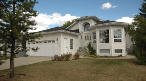 Stunning Family Home with Basement In-Law Suite in Family Friendly Community of Wild Rose